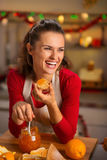 Housewife tasting orange marmalade in Christmas kitchen Royalty Free Stock Image