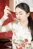 Housewife tasting soup Stock Photography