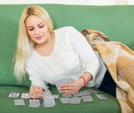 Housewife telling fortunes by cards Stock Photo