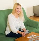 Housewife telling fortunes by cards Royalty Free Stock Image