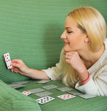 Housewife telling fortunes by cards Royalty Free Stock Images