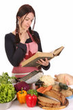 Housewife thinking with a book recipe Stock Photos