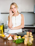 Housewife thinking what to cook for dinner Stock Photos