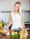 Housewife thinking what to cook for dinner Stock Image