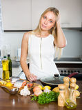 Housewife thinking what to cook for dinner Royalty Free Stock Images