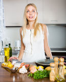 Housewife thinking what to cook for dinner Royalty Free Stock Photography