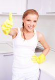 Housewife with thumb up Stock Photo