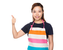 Housewife with thumb up Stock Photography