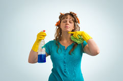 Housewife is tired of cleaning, she is fed up of cleaning. On blue background Stock Image