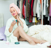 Housewife treating her face skin Stock Images