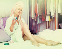 Housewife treating her face skin Royalty Free Stock Image