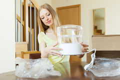 Housewife unpacking new electric steamer Royalty Free Stock Photo