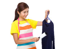 Housewife use dust roller romover on knitwear Stock Photo