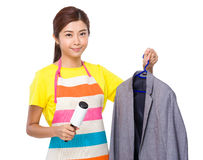 Housewife use of dust wheel and suit jacket Royalty Free Stock Images