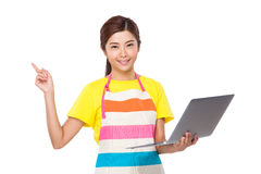 Housewife use of laptop and finger pointing up Stock Images