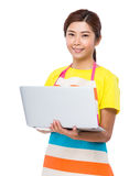 Housewife use of notebook computer Stock Images