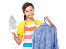 Housewife use steam iron and suit jacket Stock Images