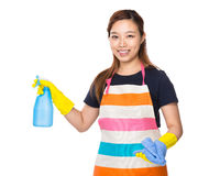 Housewife using rag and detergent spray Royalty Free Stock Image