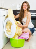 Housewife using washing machine Royalty Free Stock Photo
