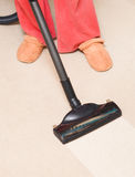 Housewife vacuum a carpet Royalty Free Stock Images