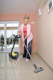 Housewife with vacuum cleaner Stock Photography
