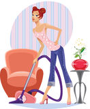 Housewife with a vacuum cleaner Royalty Free Stock Photography