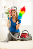 Housewife With Vacuum Cleaner And Duster Royalty Free Stock Photos