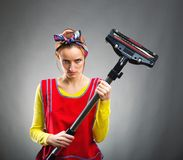Housewife with vacuum cleaner Royalty Free Stock Image