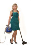 The housewife with vacuum cleaner2 Royalty Free Stock Photo