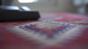 Housewife vacuuming carpet at home, slow motion