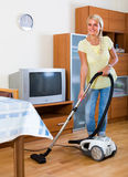 Housewife vacuuming at home Stock Photos