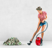 Housewife vacuuming money Stock Images