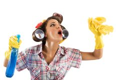 Housewife. Vintage housewife cleans with spray and cloth Royalty Free Stock Image