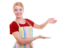 Housewife or waitress making inviting welcome gesture kitchen apron isolated Royalty Free Stock Images