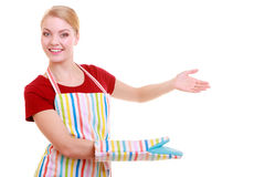 Housewife or waitress making inviting welcome gesture kitchen apron isolated Royalty Free Stock Image