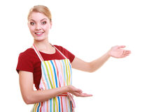 Housewife or waitress making inviting welcome gesture kitchen apron isolated Royalty Free Stock Photography