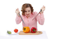Housewife wants to eat sweet peppers. Royalty Free Stock Photo