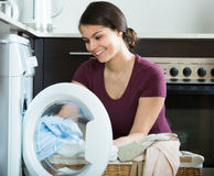 Housewife with washed linen Royalty Free Stock Image