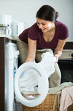 Housewife with washed linen Stock Photo