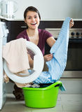 Housewife with washed linen Royalty Free Stock Images