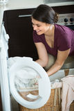 Housewife with washed linen Royalty Free Stock Photo