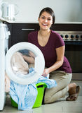 Housewife with washed linen Stock Photos