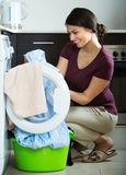 Housewife with washed linen Stock Image
