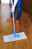 Housewife washes floor of mop Royalty Free Stock Photography