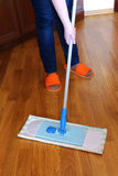 Housewife washes floor of mop Royalty Free Stock Images