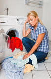 Housewife washing. A young housewife with washing machine and clothes. Washing day Stock Photography