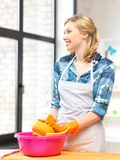 Housewife washing dish at the kitchen Stock Photography