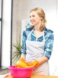 Housewife washing dish at the kitchen Stock Image