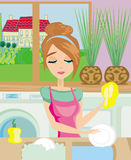 Housewife washing the dishes Royalty Free Stock Photos