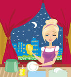 Housewife washing the dishes at night Royalty Free Stock Photography